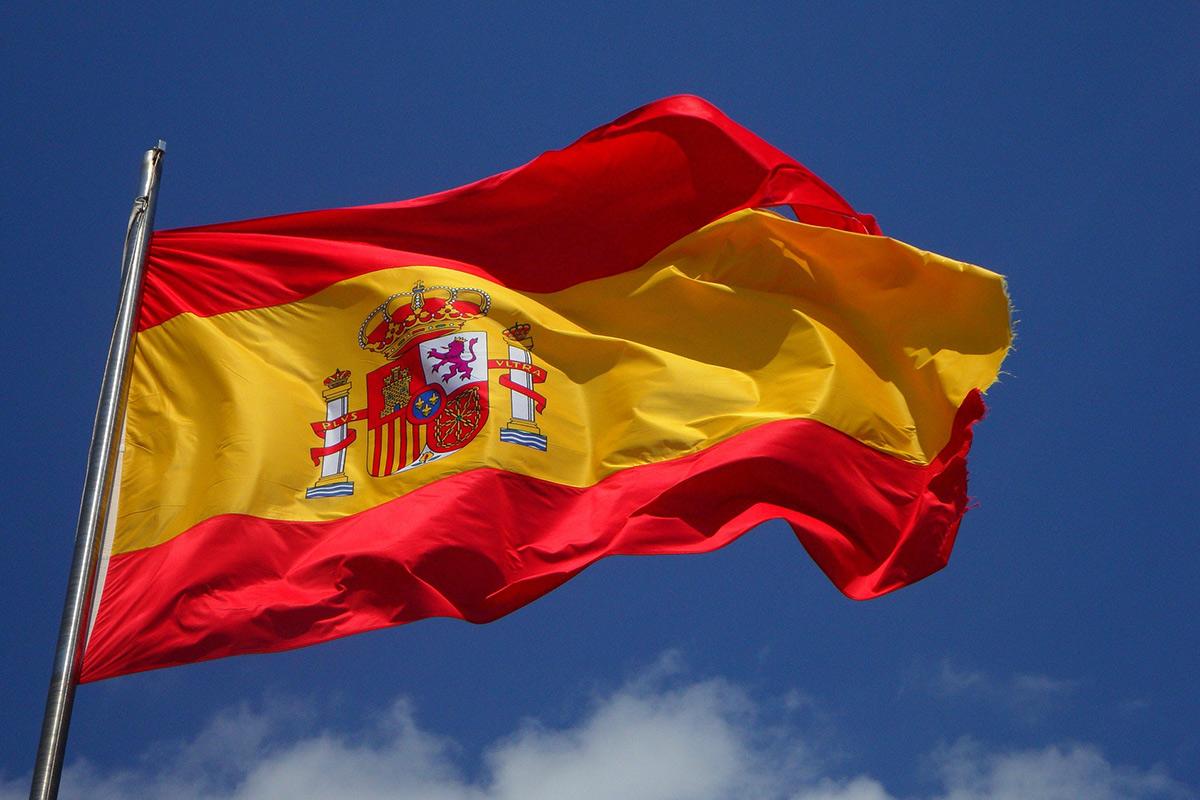 Spanish flag flying against a blue sky